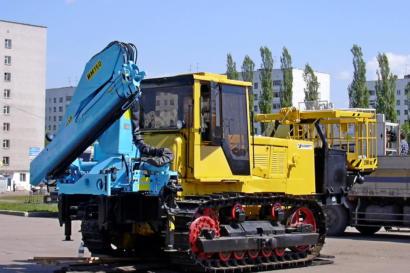 Гусеничный трактор с КМУ ИНМАН ИМ 150