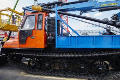 Трелевочный трактор с краном-манипулятором ИНМАН ИМ 180 с буром и люлькой